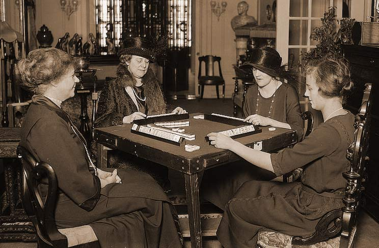 Women playing the traditional, Asian version of Mahjong